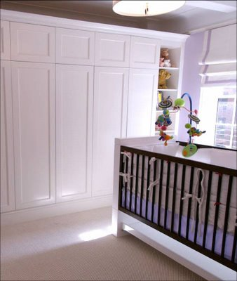 area interior design janine carendi nursery closet open to reveal changing table wall unit white wood crib baby room
